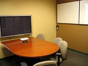 Photograph of a group study room with plasma screen