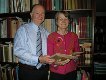 Drs. Sheldon and Leena Peck in their home library