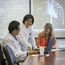 a picture of clinicians sitting at a desk