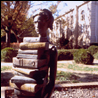 Statue of woman holding books