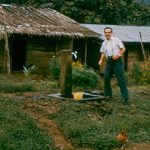 Dr. Okun at a water source in a rural setting