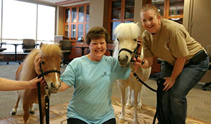 Lynn Gunter with the therapy ponies at HSL