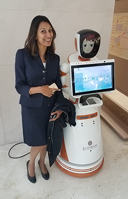 Dr. Nandita Mani and robot at the Fudan Medical Center in China