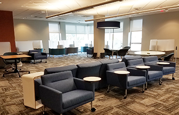 soft seating, tables, and pods for studying